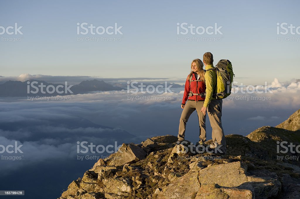 Hikers enjoy view at the summit royalty-free stock photo