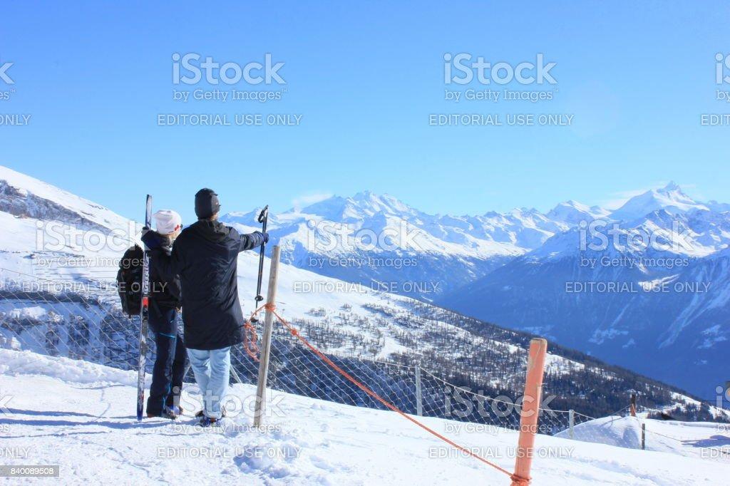 Hikers enjoying view of Swiss alps from Kandersteg, Switzerland, February 2017 stock photo