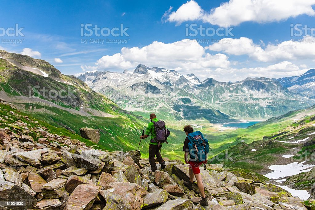 Hikers explore the mountain valley stock photo