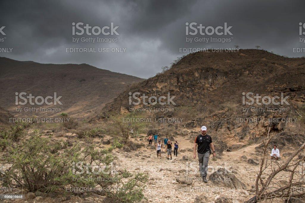 hikers in Dhofar mountains in Salalah stock photo