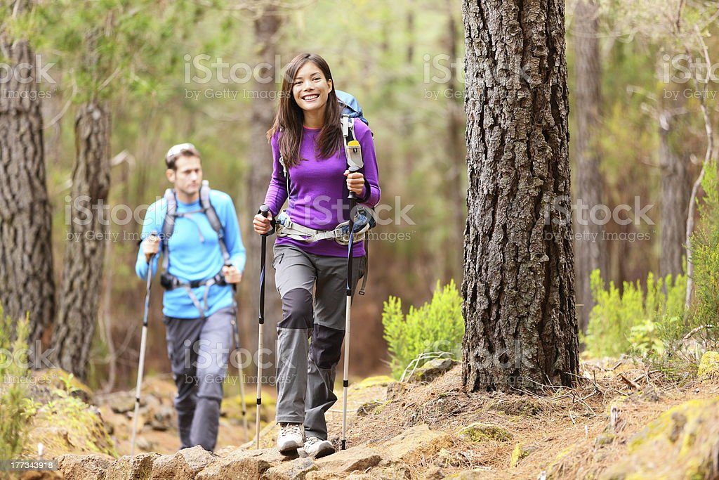Hikers in forest stock photo