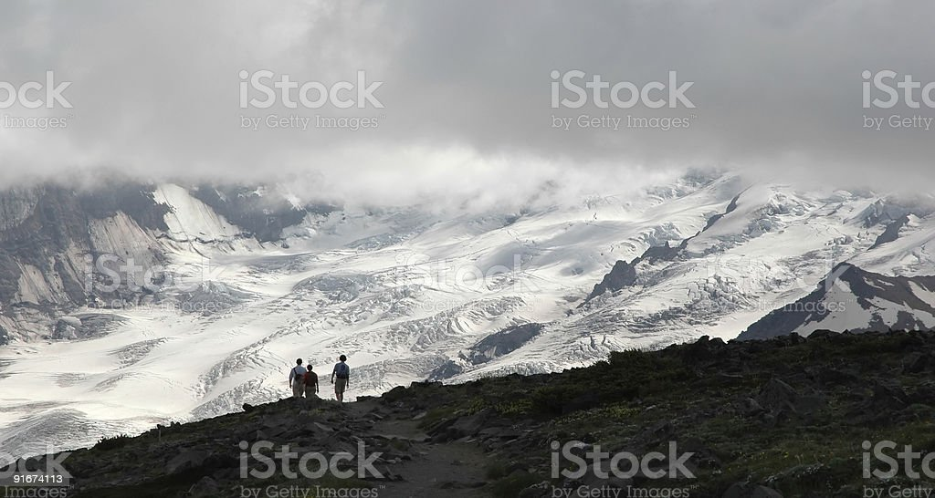 Hikers in front of Mt. Rainier royalty-free stock photo