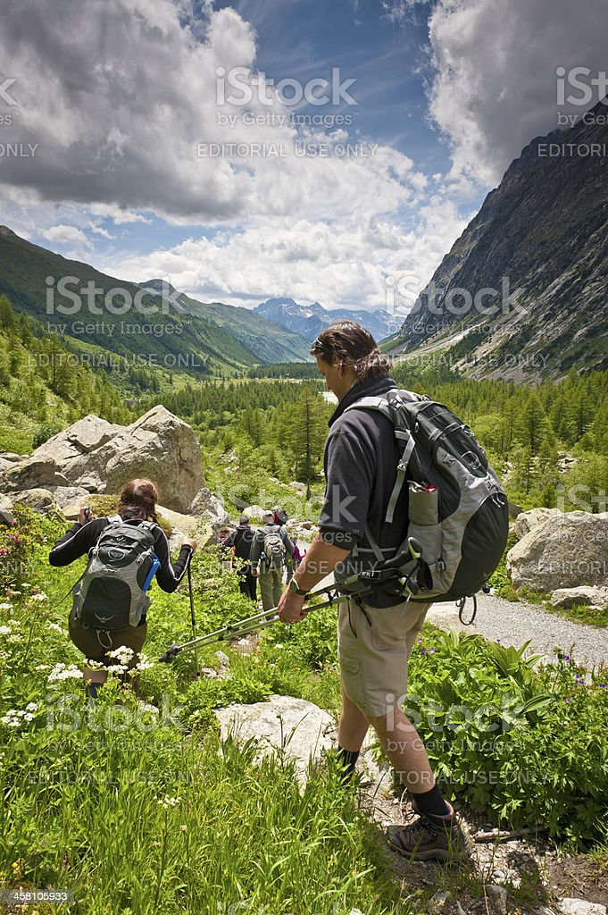 Hikers in idyllic Alpine mountain landscape Val Ferret Italy royalty-free stock photo