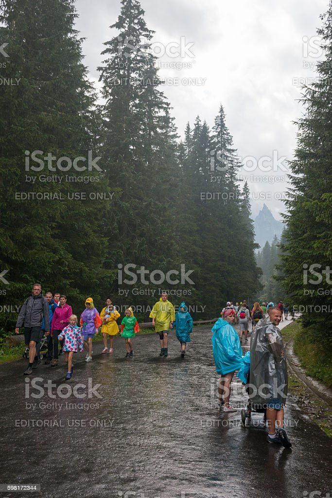 Hikers in rain at Morskie Oko, Poland stock photo
