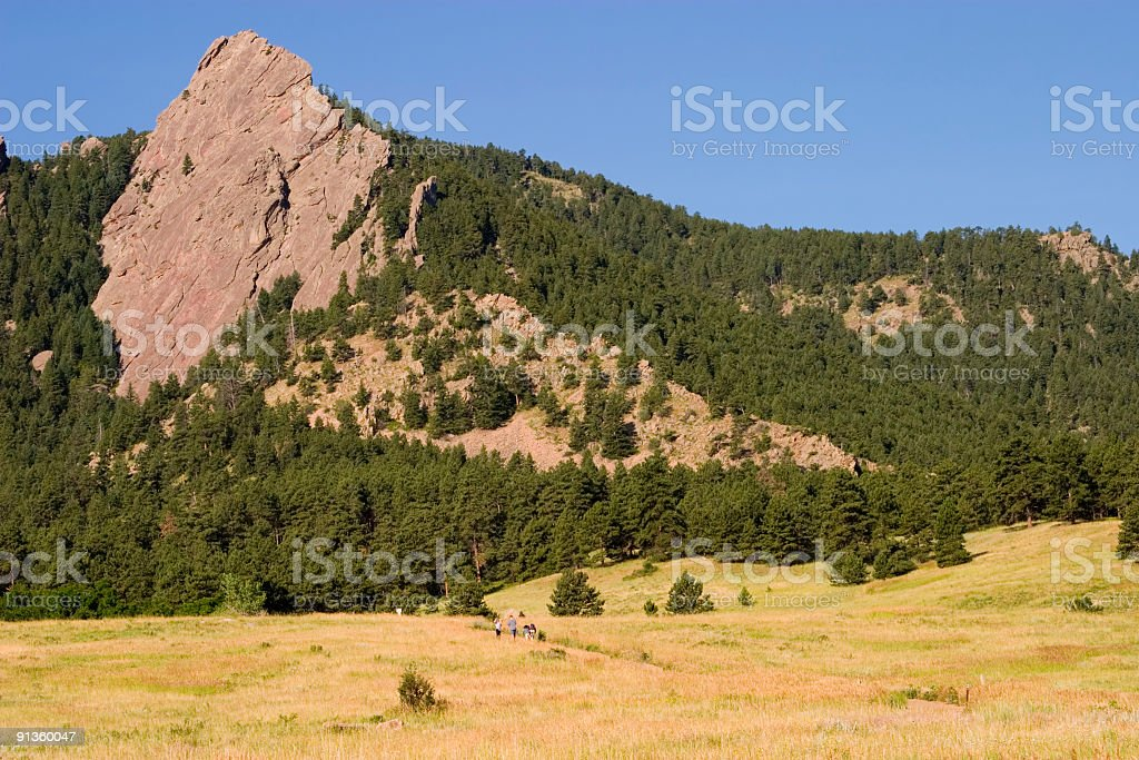 Hikers in the Flatirons royalty-free stock photo