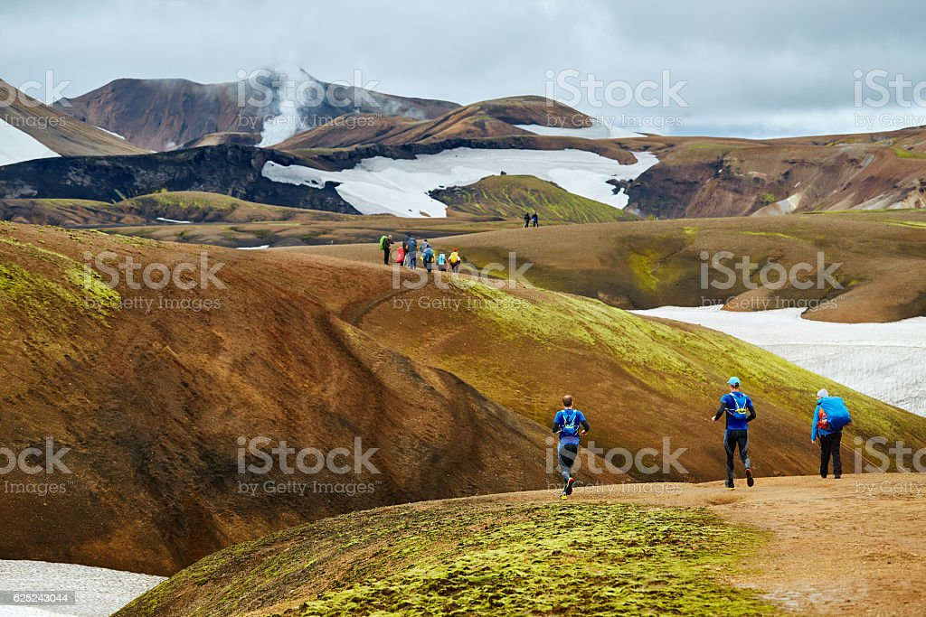 hikers in the mountains, Iceland stock photo