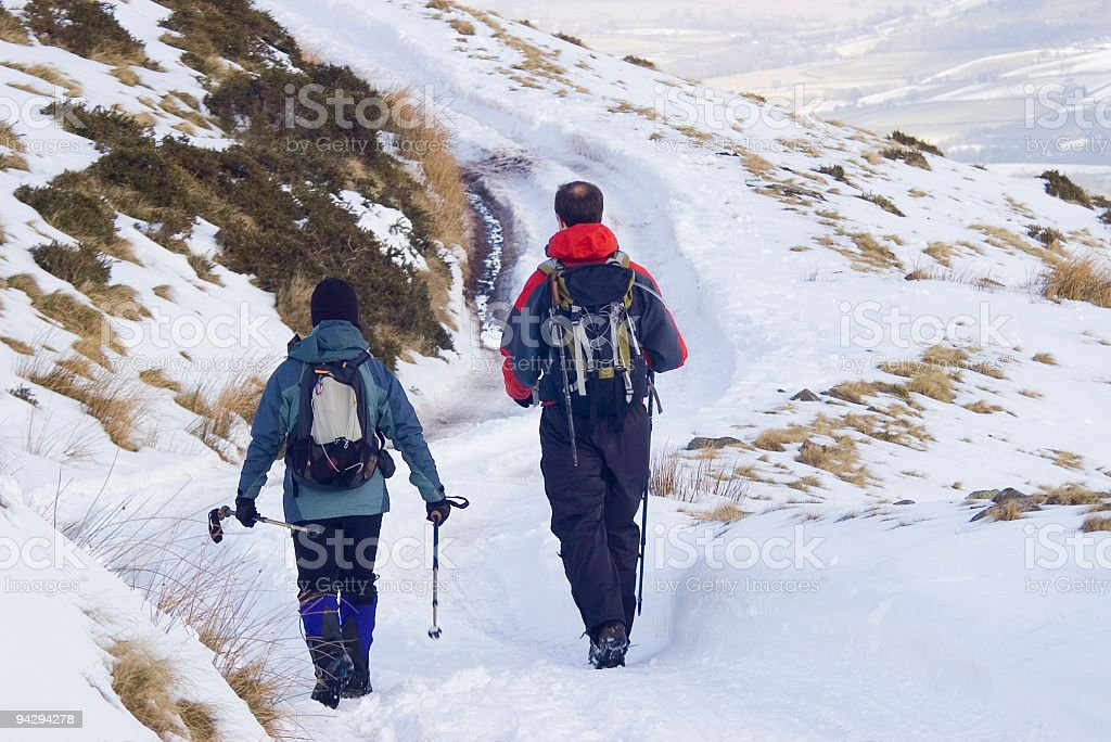 Hikers in the snow royalty-free stock photo