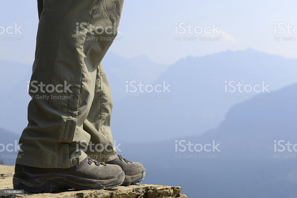 Hiker's Legs and Boots at Mountain Overlook royalty-free stock photo