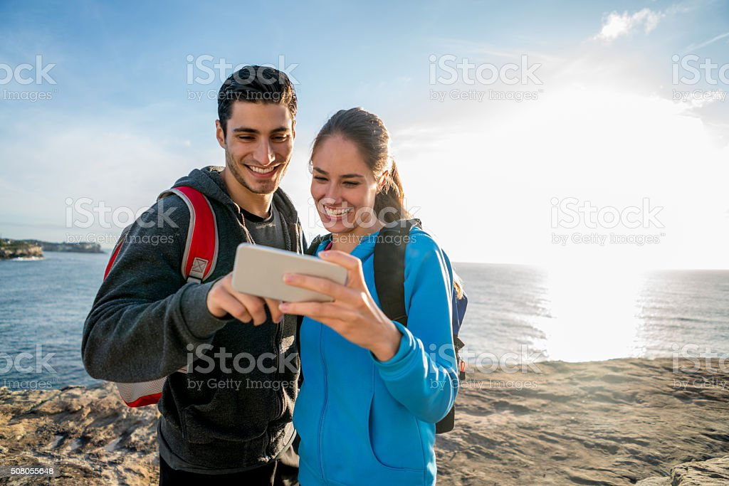 Hikers looking at a selfie stock photo