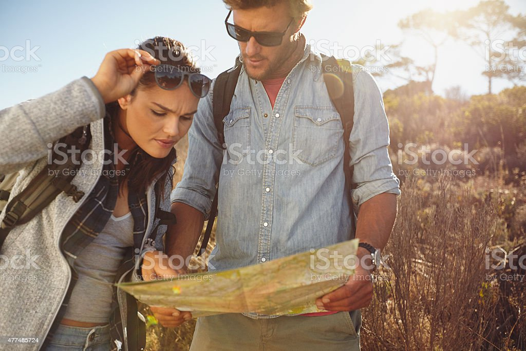Hikers looking at map for navigation stock photo