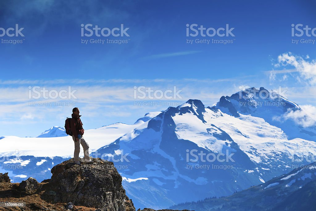 Hiker's mission accomplished stock photo