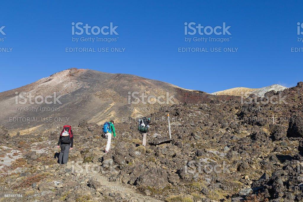 Hikers no the Tongariro crossing, New Zealand stock photo