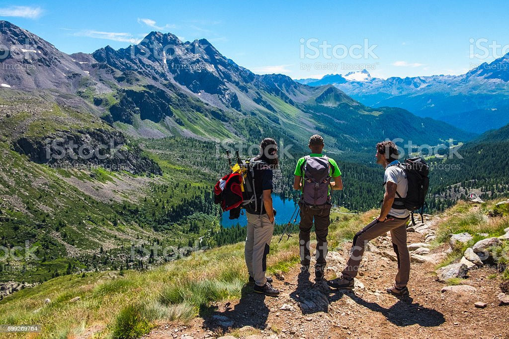 Hikers on a mountain path stock photo