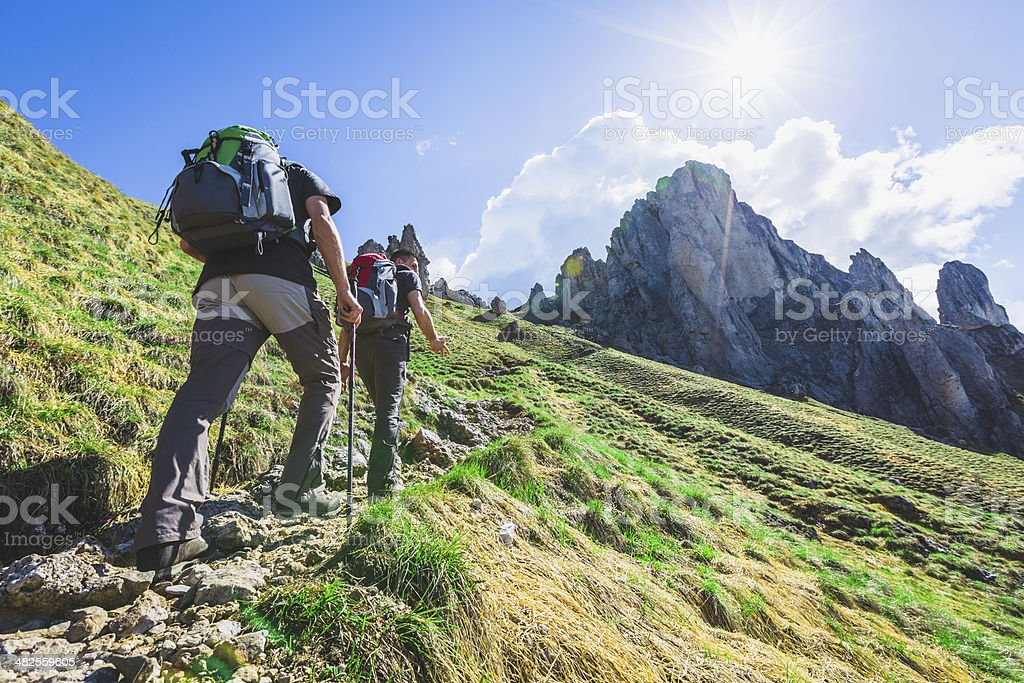 Hikers on Alps Mountain Trail stock photo