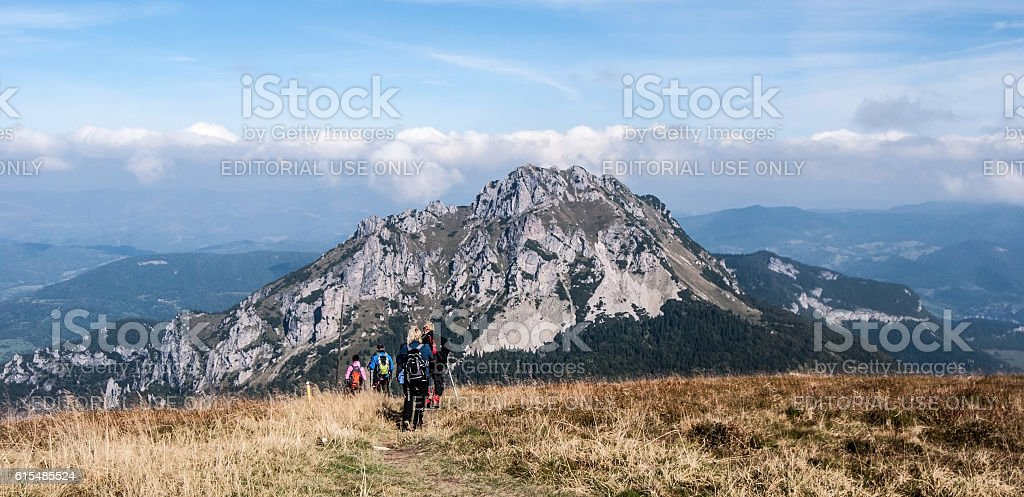 hikers on autumn Stoh with Velky Rozsutec in Mala Fatra stock photo