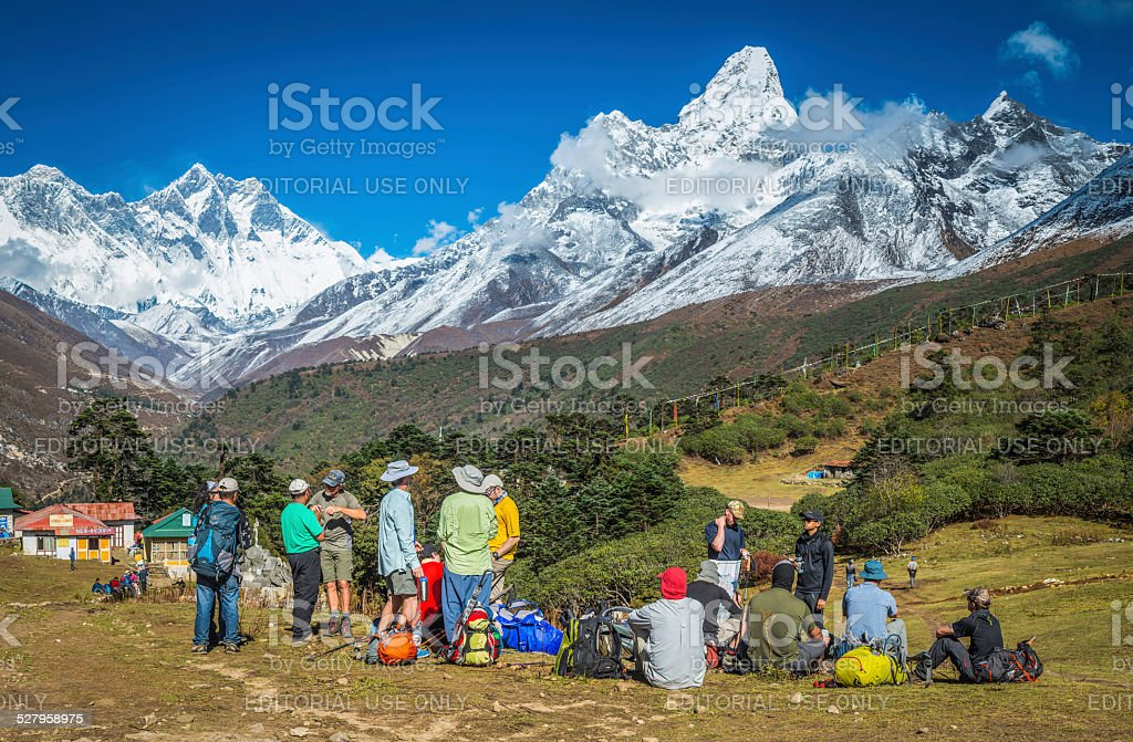 Hikers on Everest Base Camp trail below Himalaya mountains Nepal stock photo