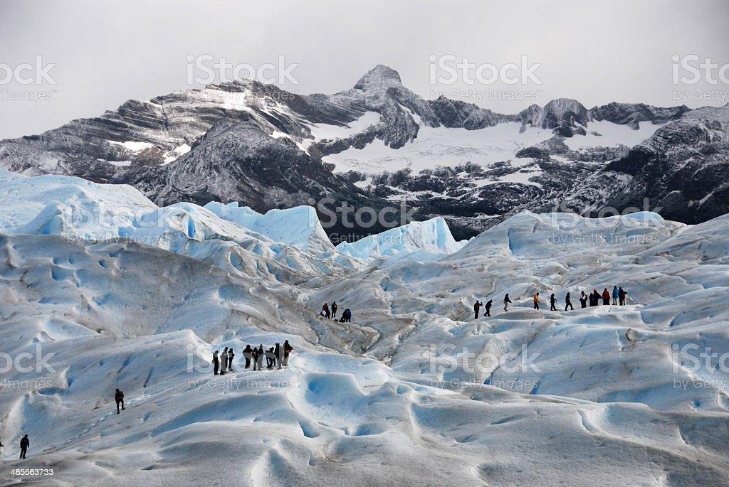 Hikers on Perito Merino Glacier in Patagonia stock photo