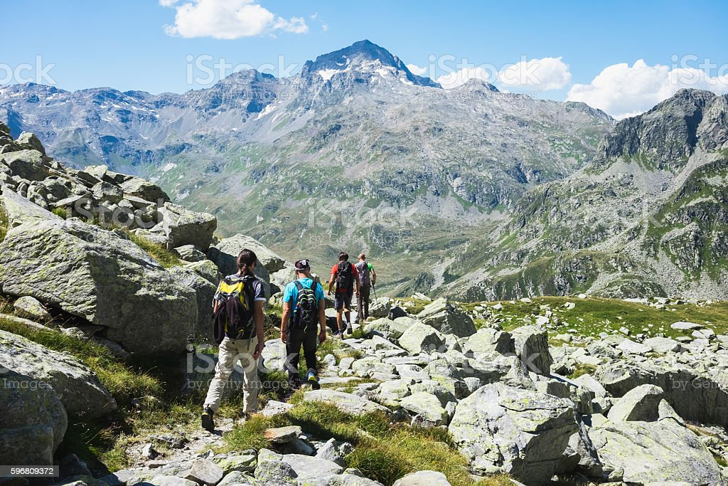 Hikers on the mountain trail stock photo