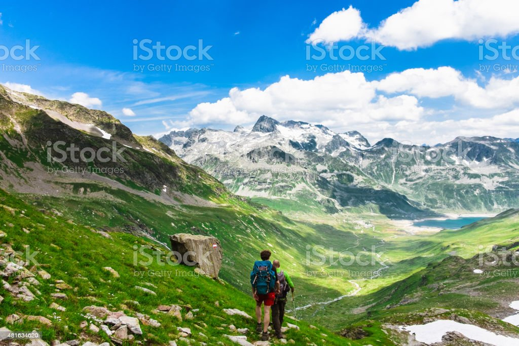 Hikers on top of mountain stock photo