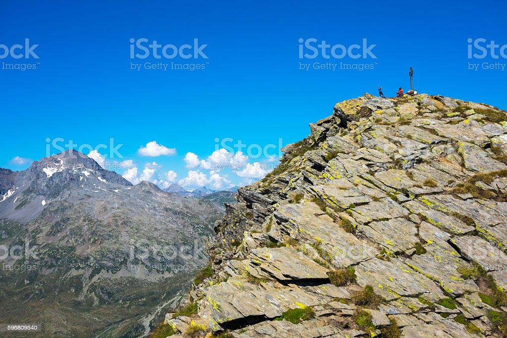Hikers on top of the mountain range stock photo