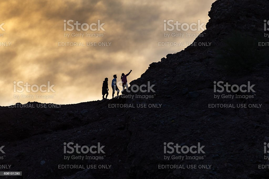 Hikers take a sunset selfie on a mountain stock photo