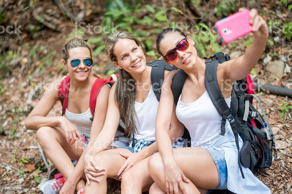 Hikers taking a selfie stock photo