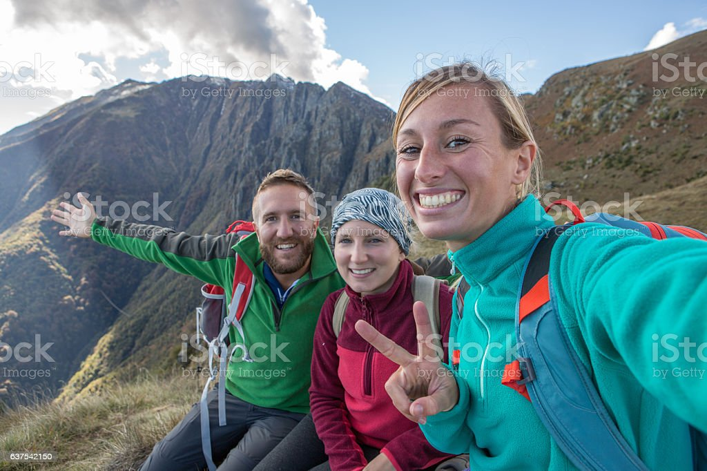 Hikers taking selfie on mountain top stock photo