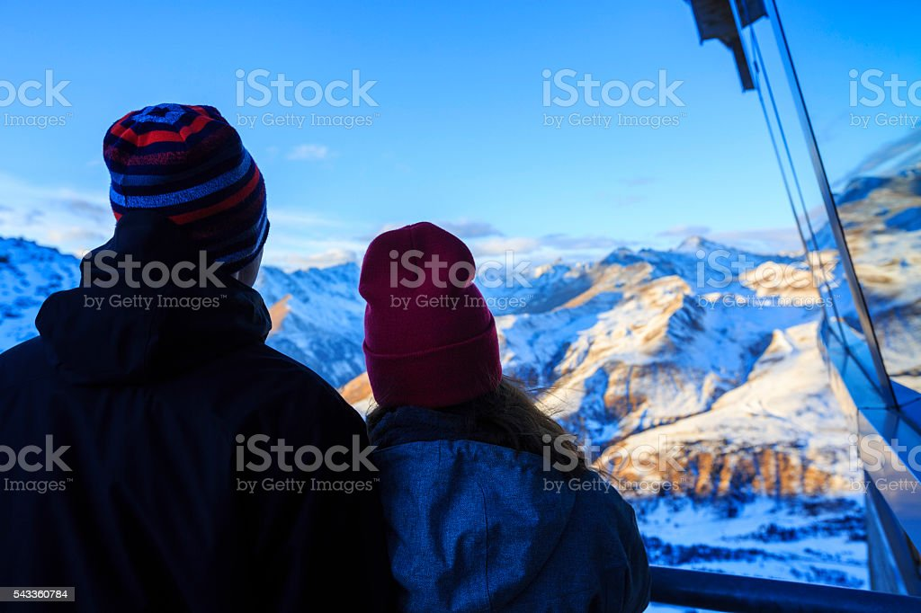 Hikers teen boy and girl enjoying in snow  Mountain Glacier stock photo