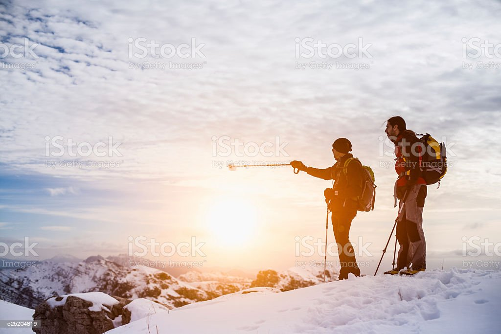 Hikers top of the mountain stock photo