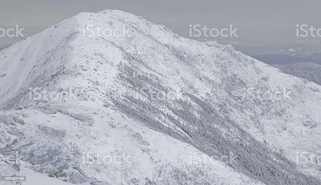 Hikers Traversing Mountainous Ridge stock photo