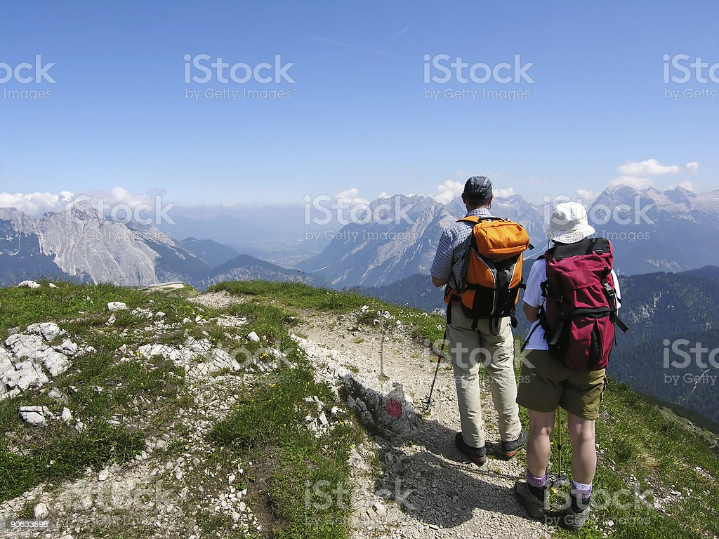 Hikers up on mountain enjoying view before going back down  stock photo