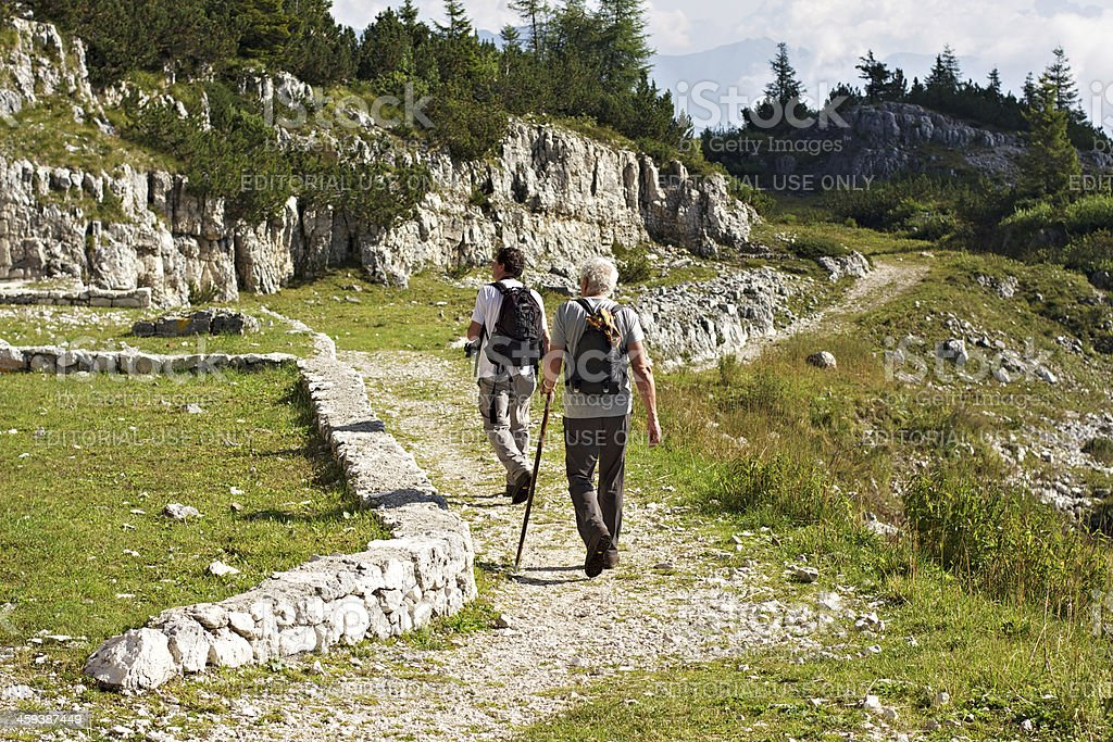 Hikers walking in the Italian Alps stock photo
