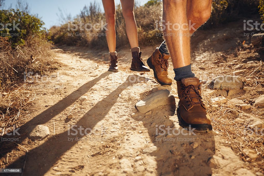 Hikers walking on the country path stock photo