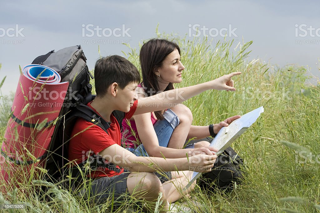 hikers with a map royalty-free stock photo