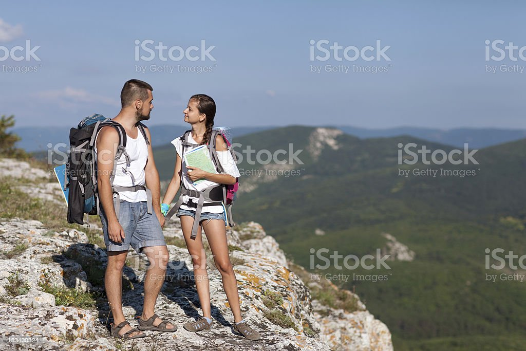 Hikers with backpacks. royalty-free stock photo