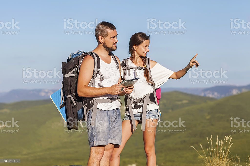 Hikers with backpacks royalty-free stock photo