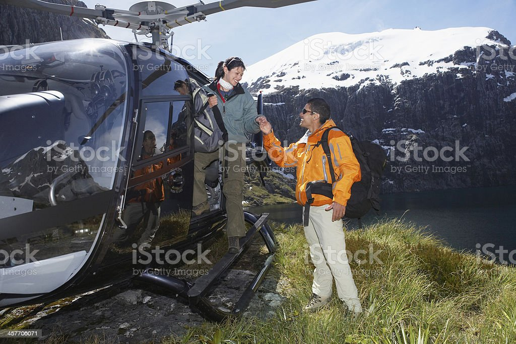 Hikers With Helicopter On Mountain Top stock photo