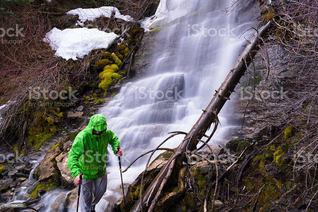 Hiking and Exploring Mountain Waterfall stock photo