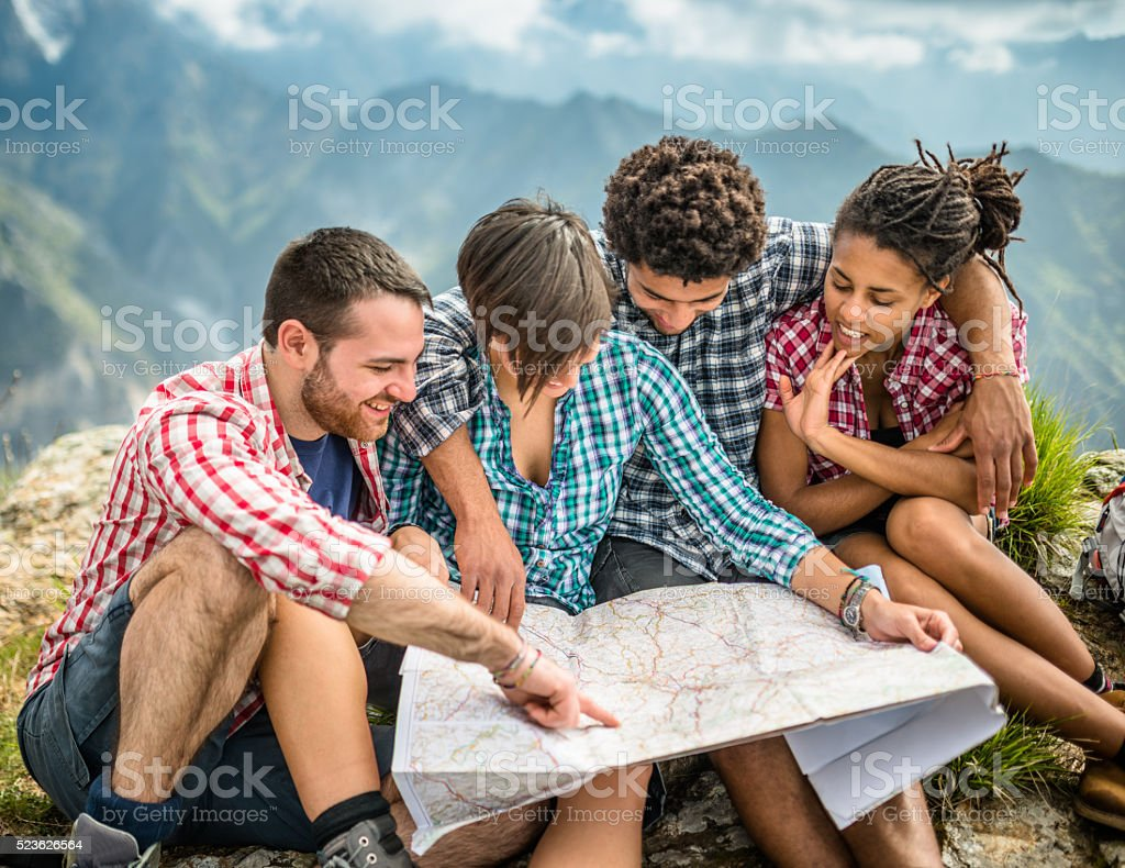 Hiking and Reading a map on the mountain stock photo