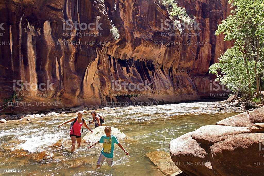 Hiking and wading in the Zion Narrows stock photo