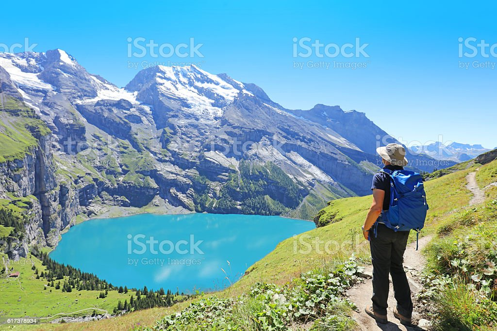 Hiking at Lake Oeschinensee in Berner Oberland in Central Switzerland stock photo