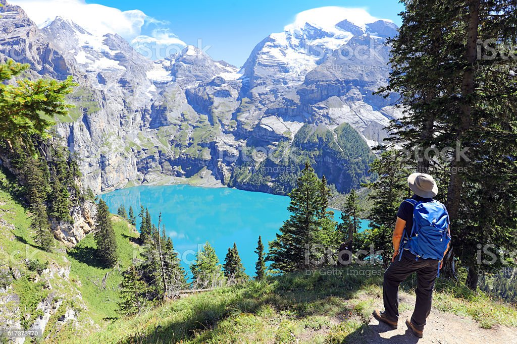 Hiking at Oeschinen Lake in Berner Oberland in Switzerland stock photo
