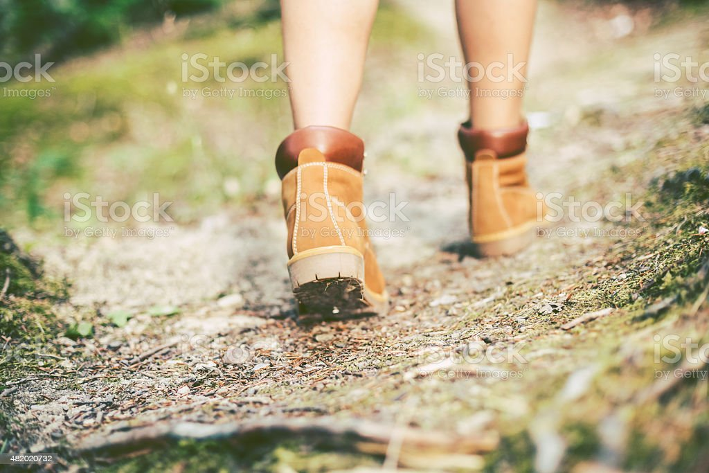 Hiking boots in outdoor action. stock photo