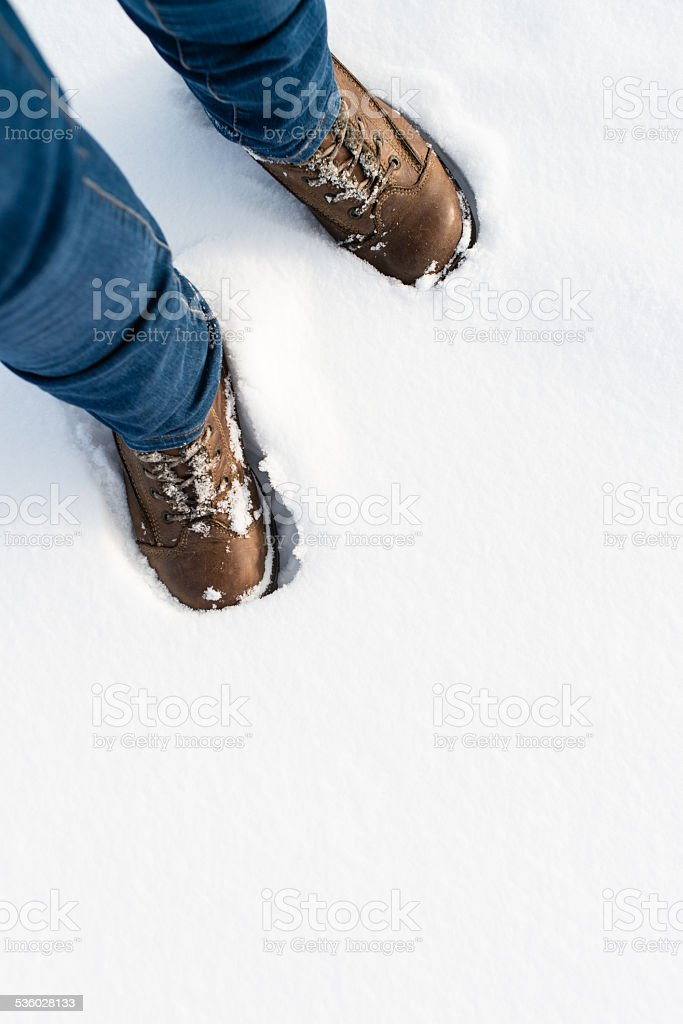 Hiking boots in the snow stock photo