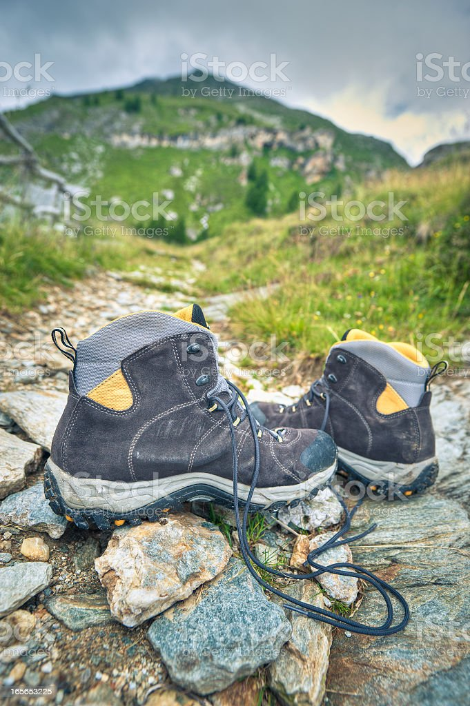Hiking Boots On A Mountain Path, Alps royalty-free stock photo