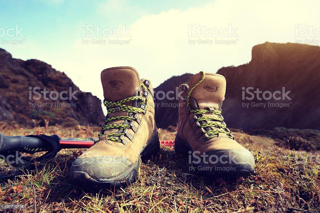 hiking boots on beautiful mountain peak stock photo