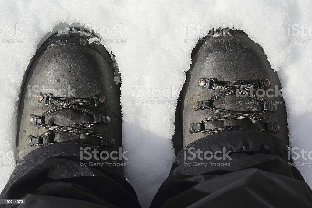 Hiking boots on snow, top view stock photo