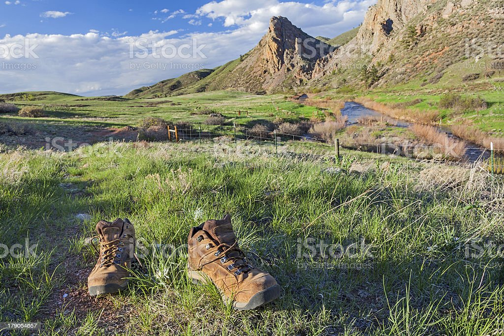 hiking boots on trail stock photo