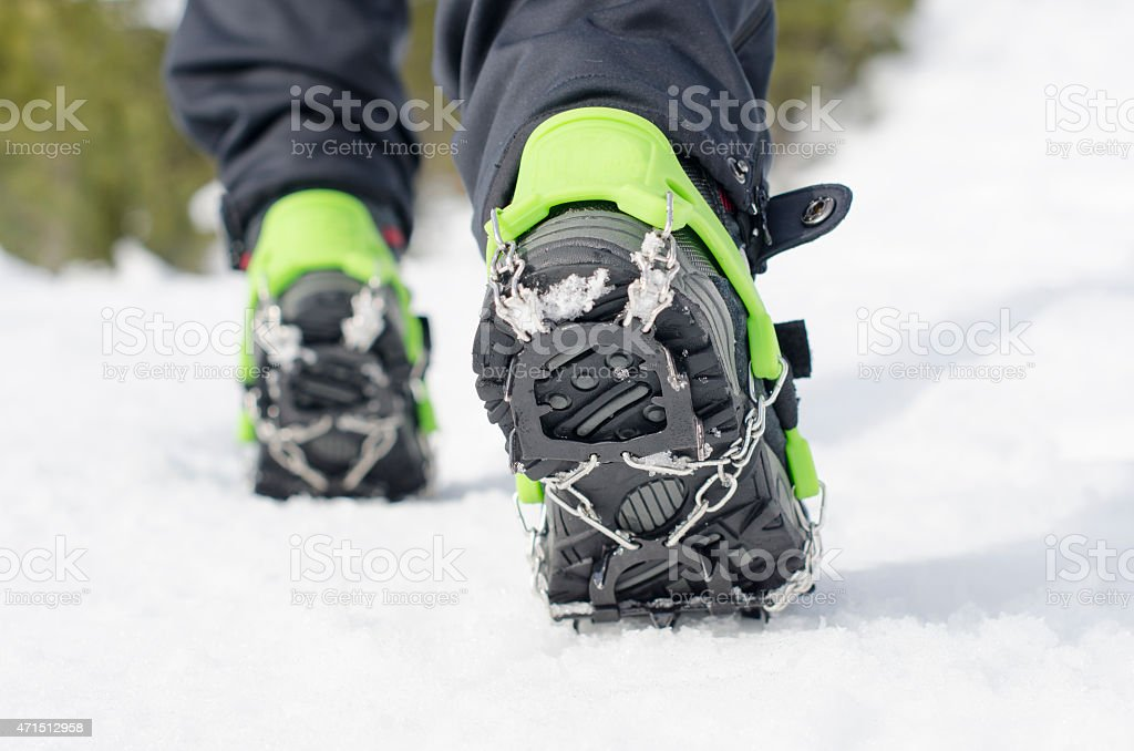 hiking boots with equipment for ice stock photo