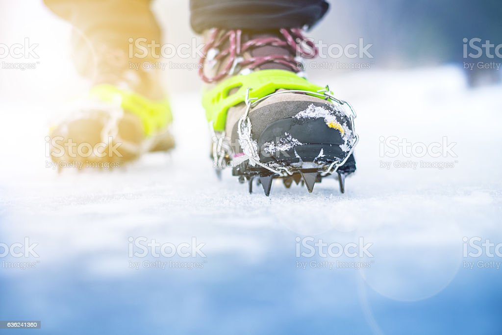 Hiking boots with equipment for ice. stock photo